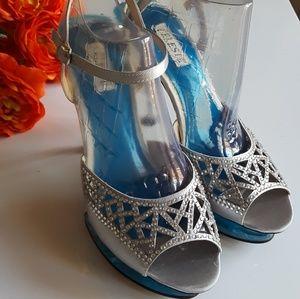 Size 9 Celeste Silver high heel stiletto pump